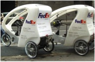 Tiny FedEx electric vehicles for delivery in Paris (Bing Images)