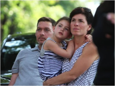 Anthony and Jeanette Senerchia of Pelham and their daughter Taya, 6, watch as local politicians participate in the ice bucket challenge, July 25, 2014 outside Pelham (NY) Town Hall. Photo: Tania Savayan; taken from lohud.com via Bing Images.