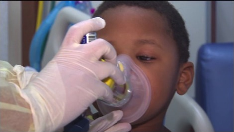 "Lakeia Lockwood, mother of D'Mari Lockwood receiving treatment, said he was ""Struggling to breathe, coughing. [Doctors] said the airways were so tight they actually, in Gary, said I almost lost him."" Taken from wgntv.com via Bing Images."