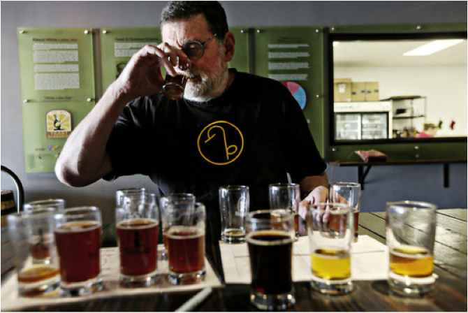 Nice work, if you can get it: Pete Slosberg, the founder of Pete's Wicked Ale, sampled beer at the lab. Credit Sandy Huffaker for The New York Times.