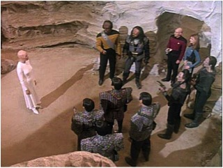 "Human, Klingon, Cardassian and Romulan representatives meet their primeval ancestor in the Alpha Quadrant. Taken from Wikipedia ""The Chase"" (Star Trek: The Next Generation; Season 6, Episode 20)."