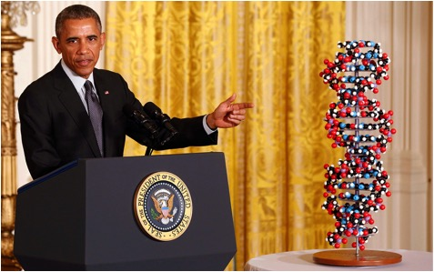 Left-handed President Obama pointing to right-handed DNA helix..Taken from America. Aljazeera.com