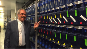 Dr. Zon and some of his 4,000 zebrafish tanks. Taken from bizjournals.com.