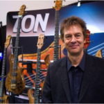 Joe Zon with some of his famous guitars at NAMM Show 2015. Taken from ilan.me.